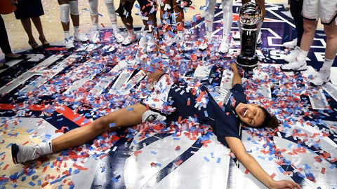 <p>               Connecticut's Olivia Nelson-Ododa makes an angel in confetti at the end of an NCAA college basketball game against Cincinnati in the American Athletic Conference tournament finals at Mohegan Sun Arena, Monday, March 9, 2020, in Uncasville, Conn. (AP Photo/Jessica Hill)             </p>
