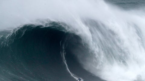 <p>               Kai Lenny from Hawaii rides a wave during the Nazare Tow Surfing Challenge at Praia do Norte or North Beach in Nazare, Portugal, Tuesday, Feb. 11, 2020. (AP Photo/Armando Franca)             </p>