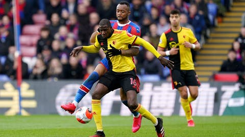 <p>               Crystal Palace's Jordan Ayew, rear, and Watford's Abdoulaye Doucoure battle for the ball during the English Premier League soccer match at Selhurst Park, London, Saturday March 7, 2020. (John Walton/PA via AP)             </p>