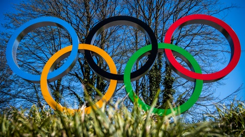<p>               The Olympic rings are pictured at the entrance of the IOC, International Olympic Committee headquarters during the coronavirus disease (COVID-19) outbreak in Lausanne, Switzerland, Tuesday, March 24, 2020. (Jean-Christophe Bott/Keystone via AP)             </p>