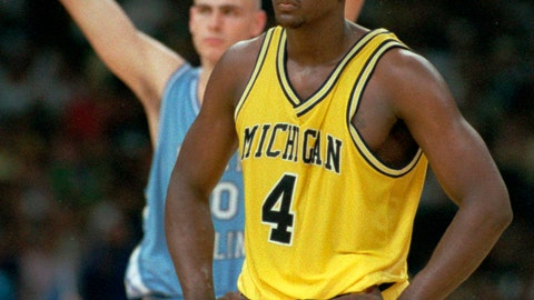 <p>               FILE - In this April 5, 1993, file photo, Michigan's Chris Webber (4) stands by as North Carolina's Eric Montross celebrates during North Carolina's technical foul shots in the final seconds of the NCAA Final Four championship game at the Superdome in New Orleans. Webber called a time out Michigan did not have, and Michigan was charged with a technical foul and lost possession of the ball. Donald Williams made all four free throws and North Carolina won the national title 77-71. (AP Photo/Susan Ragan, File)             </p>