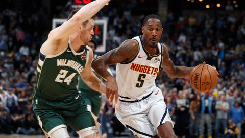 <p>               Denver Nuggets forward Will Barton, right, drives to the basket past Milwaukee Bucks guard Pat Connaughton in the first half of an NBA basketball game Monday, March 9, 2020, in Denver. (AP Photo/David Zalubowski)             </p>
