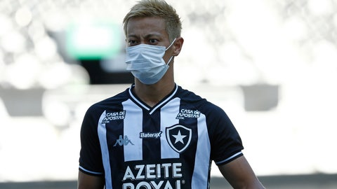 <p>               Japan's Keisuke Honda of Brazil's Botafogo wears a mask before a Carioca Championship soccer match against Bangu in Rio de Janeiro, Brazil, Sunday, March 15, 2020. The match was played in an empty, closed door stadium to contain transmission of the new coronavirus. (AP Photo/Bruna Prado)             </p>