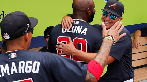 <p>               Atlanta Braves' Marcell Ozuna hugs Martin Prado, right, in the dugout before a spring training baseball game against the Tampa Bay Rays, Tuesday, March 3, 2020, in Venice, Fla. (AP Photo/Elise Amendola)             </p>