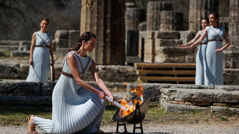 <p>               Greek actress Xanthi Georgiou, playing the role of the High Priestess, lights up the torch during the flame lighting ceremony at the closed Ancient Olympia site, birthplace of the ancient Olympics in southern Greece, Thursday, March 12, 2020. Greek Olympic officials are holding a pared-down flame-lighting ceremony for the Tokyo Games due to concerns over the spread of the coronavirus. Both Wednesday's dress rehearsal and Thursday's lighting ceremony are closed to the public, while organizers have slashed the number of officials from the International Olympic Committee and the Tokyo Organizing Committee, as well as journalists at the flame-lighting. (AP Photo/Thanassis Stavrakis)             </p>