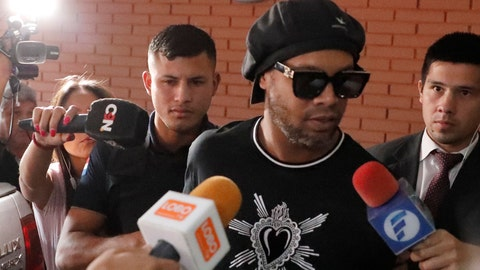<p>               Former Brazilian soccer star Ronaldinho, or Ronaldo de Assis Moreira, enters Paraguay's attorney offices in Asuncion, Paraguay, Thursday, March 5, 2020. According to local news, Ronaldinho is accused of arriving in the country with a fake Paraguay passport. (AP Photo/Jorge Saenz)             </p>