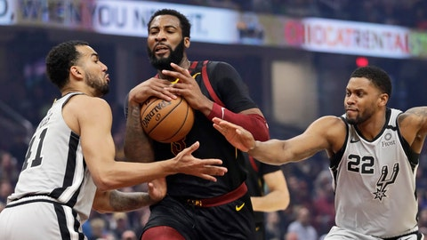 <p>               Cleveland Cavaliers' Andre Drummond, center, drives between San Antonio Spurs' Trey Lyles, left, and Rudy Gay, right, in the first half of an NBA basketball game, Sunday, March 8, 2020, in Cleveland. (AP Photo/Tony Dejak)             </p>