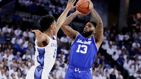 <p>               Seton Hall's Myles Powell (13) shoots against Creighton's Ty-Shon Alexander (5) during the first half of an NCAA college basketball game in Omaha, Neb., Saturday, March 7, 2020. (AP Photo/Nati Harnik)             </p>