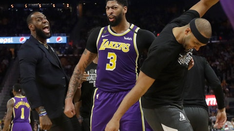 <p>               Los Angeles Lakers' LeBron James, left, celebrates with Anthony Davis (3) and Jared Dudley during the second half of an NBA basketball game against the Golden State Warriors in San Francisco, Thursday, Feb. 27, 2020. (AP Photo/Jeff Chiu)             </p>