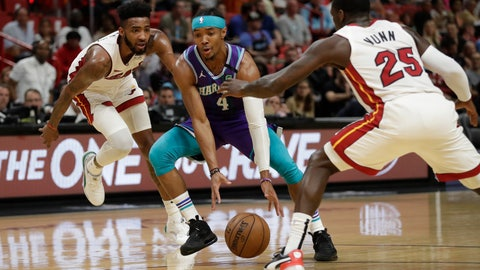 <p>               Charlotte Hornets guard Devonte' Graham (4) drives to the basket past Miami Heat guard Kendrick Nunn (25) and forward Derrick Jones Jr. during the first half of an NBA basketball game, Wednesday, March 11, 2020, in Miami. (AP Photo/Wilfredo Lee)             </p>