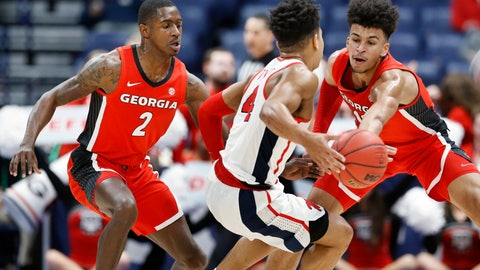 <p>               Georgia's Jordan Harris (2) and Toumani Camara, right, block the path of Mississippi's Breein Tyree (4) in the first half of an NCAA college basketball game in the Southeastern Conference Tournament Wednesday, March 11, 2020, in Nashville, Tenn. (AP Photo/Mark Humphrey)             </p>