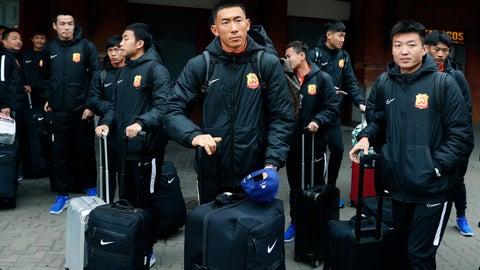 """<p>               Players of the Chinese Super League team Wuhan Zall arrive at the Atocha train station in Madrid, Spain, Saturday, Feb. 29, 2020. The Chinese first-division soccer club from the city of Wuhan enters its second month in Spain without knowing when it will be able to return home. . It hasn't been easy for the nearly 50 members of the Wuhan Zall squad, but on Sunday they will get some reprieve from their ordeal by attending the Spanish league """"clasico"""" between Real Madrid and Barcelona at the Santiago Bernabeu Stadium in Madrid. (AP Photo/Manu Fernandez)             </p>"""