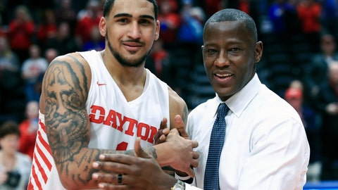 <p>               FILE - In this Feb. 22, 2020, file photo, Dayton's Obi Toppin, left, celebrates scoring his 1,000th career point with head coach Anthony Grant after an NCAA college basketball game against Duquesne, in Dayton, Ohio. Toppin and Grant have claimed top honors from The Associated Press after leading the Flyers to a No. 3 final ranking. Toppin was voted the AP men's college basketball player of the year, Tuesday, March 24, 2020. Grant is the AP coach of the year. (AP Photo/Aaron Doster, File)             </p>