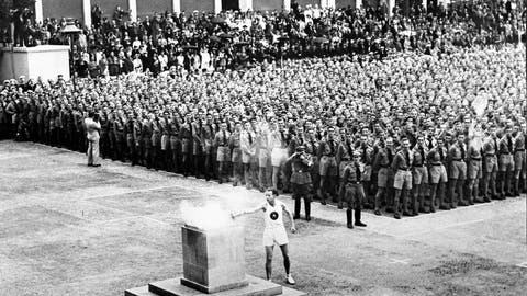 <p>               FILE - In this Aug. 1, 1936, file photo, the lighting of the Olympic fire in Lustgarten, Berlin, where it will be guarded by members of the Hitler Youth until it is brought to the Olympic stadium for the opening of the games in the afternoon. The torch relay was not always a fixture of the modern Olympics, which began in 1896. The relay tradition began with Adolph Hitler's 1936 Olympics in Berlin, the Games of the XI Olympiad, and was the brainchild of Dr. Carl Diem who was the head of the organizing committee. (AP Photo/File)             </p>