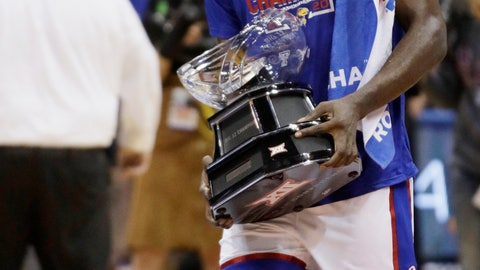 <p>               Kansas senior center Udoka Azubuike carries the Big 12 regular-season championship trophy following the team's NCAA college basketball game against TCU in Lawrence, Kan., Wednesday, March 4, 2020. (AP Photo/Orlin Wagner)             </p>