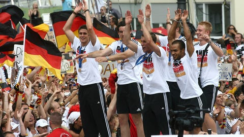 <p>               FILE - In this Sunday July 9, 2006 file photo, players of Germany's national soccer team celebrate with fans at the 'Fan Mile' in Berlin. Thousands of German soccer fans celebrate their team after Germany beat Portugal 3:1 at the third place match of the soccer World Cup on Saturday. Five years into a sprawling investigation of soccer corruption, the first courtroom trial in Switzerland is due to begin Monday, March 9, 2020 in a 2006 World Cup fraud case. Sepp Blatter, the former FIFA president, and German soccer great Franz Beckenbauer are listed by Switzerland's federal criminal court to testify in the trial of four soccer officials implicated in a suspect 6.7 million euros ($7.6 million) payment.  (AP Photo/markus Schreiber)             </p>