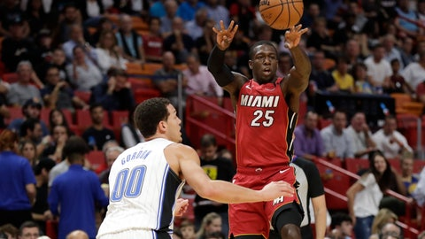 <p>               Miami Heat guard Kendrick Nunn (25) passes the ball past Orlando Magic forward Aaron Gordon (00) during the first half of an NBA basketball game Wednesday, March 4, 2020, in Miami. (AP Photo/Wilfredo Lee)             </p>