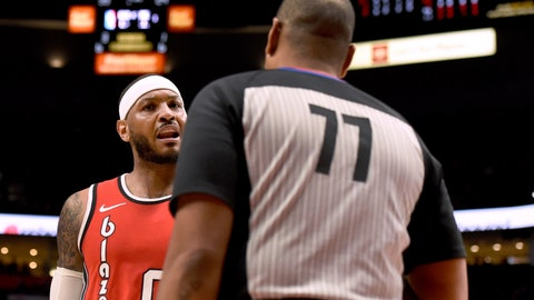 <p>               Portland Trail Blazers forward Carmelo Anthony, left, has some words with referee Karl Lane, right, during the first quarter of the team's NBA basketball game against the Phoenix Suns in Portland, Ore., Tuesday, March 10, 2020. (AP Photo/Steve Dykes)             </p>