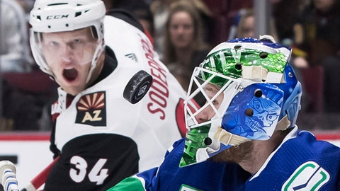 <p>               Vancouver Canucks goalie Thatcher Demko, right, makes a save as Arizona Coyotes' Carl Soderberg, of Sweden, watches during the first period of an NHL hockey game Wednesday, March 4, 2020, in Vancouver, British Columbia. (Darryl Dyck/The Canadian Press via AP)             </p>