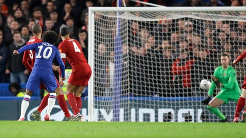 <p>               Chelsea's Willian, second left, kicks the ball to score has team's first goal during the English FA Cup fifth round soccer match between Chelsea and Liverpool at Stamford Bridge stadium in London Wednesday, March 4, 2020. (AP Photo/Kirsty Wigglesworth)             </p>