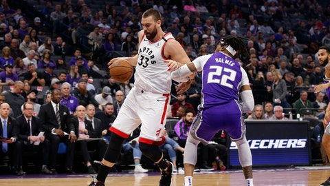 <p>               Toronto Raptors center Marc Gasol, left, tries to drive around Sacramento Kings center Richaun Holmes, right, during the first quarter of an NBA basketball game in Sacramento, Calif., Sunday, March 8, 2020. (AP Photo/Rich Pedroncelli)             </p>