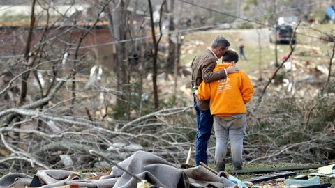 <p>               Tennessee Gov. Bill Lee, left, prays with Kayla Cowen, right, as Cowen looks through rubble in hopes of finding a neighbor Tuesday, March 3, 2020, near Cookeville, Tenn. Lee was touring damaged areas and met Cowen as she was searching. Tornadoes ripped across Tennessee early Tuesday, shredding buildings and burying people in piles of rubble and wrecked basements. (AP Photo/Mark Humphrey)             </p>