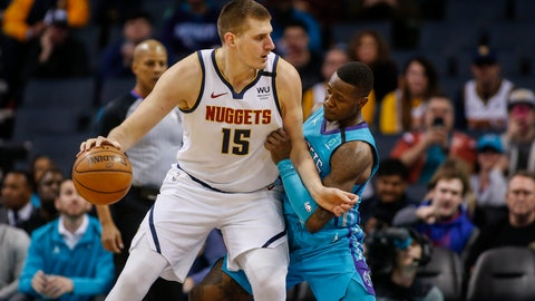 <p>               Denver Nuggets center Nikola Jokic, left, drives into Charlotte Hornets guard Terry Rozier during the first half of an NBA basketball game in Charlotte, N.C., Thursday, March 5, 2020. (AP Photo/Nell Redmond)             </p>