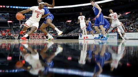 <p>               Bradley's Darrell Brown Jr. (5) heads to the basket past Drake's D.J. Wilkins during the first half of an NCAA college basketball game in the semifinal round of the Missouri Valley Conference men's tournament Saturday, March 7, 2020, in St. Louis. (AP Photo/Jeff Roberson)             </p>