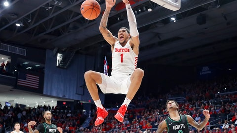 <p>               FILE - In this Dec. 17, 2019, file photo, Dayton's Obi Toppin (1) dunks as North Texas' Javion Hamlet (3) looks on during the second half of an NCAA college basketball game in Dayton, Ohio. Toppin is the lone unanimous first-team choice to The Associated Press men's college basketball All-America team, Friday, March 20, 2020. (AP Photo/John Minchillo, File)             </p>