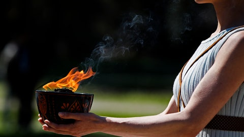 <p>               FILE - In this March 12, 2020, file photo, an actress, playing the role of the priestess, holds the flame during the flame lighting ceremony at the closed Ancient Olympia site, birthplace of the ancient Olympics in southern Greece. The Olympic flame from Greece is set to arrive in Japan even as the opening of the the Tokyo Games in four months is in doubt with more voices suggesting the games should to be postponed or canceled because of the worldwide virus pandemic. (AP Photo/Thanassis Stavrakis, File)             </p>