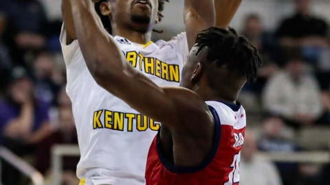 <p>               Northern Kentucky guard Jalen Tate (11) shoots over Illinois-Chicago guard Godwin Boahen (25) during the first half of an NCAA college basketball game for the Horizon League men's tournament championship in Indianapolis, Tuesday, March 10, 2020. (AP Photo/Michael Conroy)             </p>