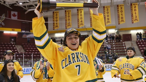 <p>               FILE - In this March 18, 2018, file photo, Clarkson's Elizabeth Giguere (7) holds up the trophy after they defeated Colgate 2-1 in overtime in the NCAA college women's hockey Frozen Four championship game in Minneapolis. The junior forward has been selected as the Patty Kazmaier Memorial Award winner, announced Friday, March 27, 2020. It's presented annually to the most outstanding player in women's college hockey. (AP Photo/Stacy Bengs, File)             </p>