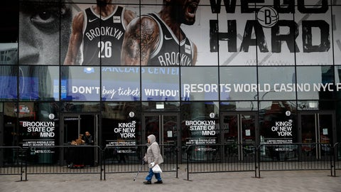 <p>               A pedestrian passes an entrance to the Barclays Center in the Brooklyn borough of New York on Thursday, March 12, 2020, after the NCAA's Atlantic 10 Conference Tournament was announced cancelled due to concerns over the COVID-19 coronavirus. (AP Photo/John Minchillo)             </p>