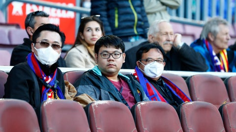 <p>               Barcelona fans wear face masks in an attempt to protect there self from the coronavirus, prior a Spanish La Liga soccer match between Barcelona and Real Sociedad at the Camp Nou stadium in Barcelona, Spain, Saturday, March 7, 2020. (AP Photo/Joan Monfort)             </p>
