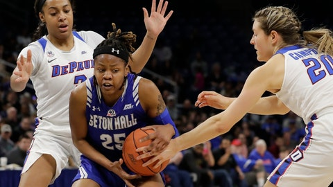 <p>               Seton Hall guard/forward Desiree Elmore (25) drives against DePaul guard Deja Church, left, and guard Kelly Campbell during the second half of an NCAA college basketball game in the Big East women's tournament semifinals, Sunday, March 8, 2020, in Chicago. (AP Photo/Nam Y. Huh)             </p>