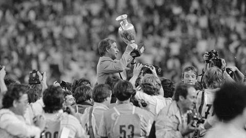 <p>               FILE - In this June 27, 1984 file photo, French soccer team coach Michel Hidalgo raises the 1984 European Championship cup as he is carried across the Parc des Princes Stadium in Paris. The French Football Federation said on its website that Hidalgo died on Thursday March 26, 2020. He was 87. (AP Photo, FILE)             </p>