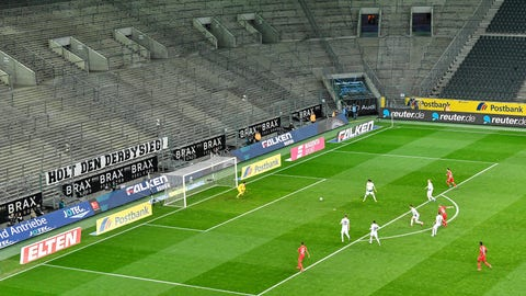 <p>               Players run for the ball in an empty stadium during the German Bundesliga soccer match between Borussia Moenchengladbach and 1.FC Cologne in Moenchengladbach, Germany, Wednesday, March 11, 2020. It is the first Bundesliga match played behind closed doors without spectators due to the coronavirus outbreak. For most people, the new coronavirus causes only mild or moderate symptoms, such as fever and cough. For some, especially older adults and people with existing health problems, it can cause more severe illness, including pneumonia. (AP Photo/Martin Meissner)             </p>