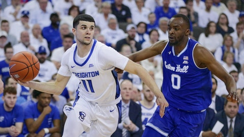 <p>               Creighton's Marcus Zegarowski (11) drives around Seton Hall's Quincy McKnight (0) during the second half of an NCAA college basketball game in Omaha, Neb., Saturday, March 7, 2020. Creighton won 77-60. (AP Photo/Nati Harnik)             </p>