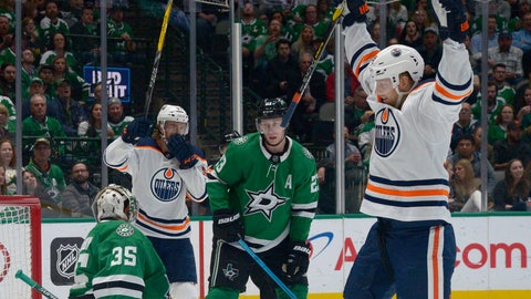 <p>               Edmonton Oilers right wing Alex Chiasson, right, and center Connor McDavid (97) celebrate a goal as Dallas Stars goaltender Anton Khudobin (35) and defenseman Esa Lindell (23) react during the second period of an NHL hockey game in Dallas, Tuesday, March 3, 2020. (AP Photo/Matt Strasen)             </p>