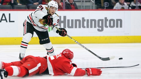 <p>               Chicago Blackhawks center Drake Caggiula (91) passes the puck against Detroit Red Wings defenseman Filip Hronek (17) during the first period of an NHL hockey game Friday, March 6, 2020, in Detroit. (AP Photo/Duane Burleson)             </p>