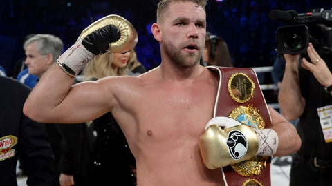 """<p>               FILE - In this Dec. 16, 2017, file photo, Billy Joe Saunders, of Britain, celebrates his win over David Lemieux, of Canada, to retain the WBO middleweight boxing title in Laval, Quebec. Saunders had his boxing license suspended Monday, March 30, 2020, after publishing a social media video in which he appeared to condone domestic violence amid the coronavirus outbreak. He has apologized for his remarks, saying: """"It was a silly mistake but I didn't mean to cause any harm to anyone and I certainly wouldn't promote domestic violence.""""(Ryan Remiorz/The Canadian Press via AP)             </p>"""