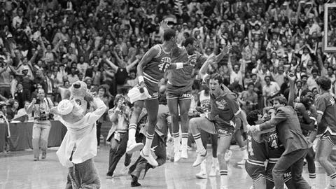 <p>               FILE - In this April 4, 1983, file photo, a high jumping Cozell McQueen (45), left center, and teammates celebrate defeating Houston 54-52 in the NCAA college basketball championship game in Albuquerque, N.M. (AP Photo/File)             </p>