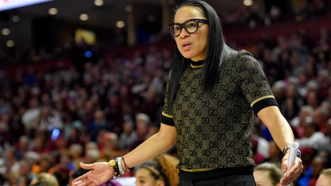 <p>               FILE - In this March 8, 2020, file photo, South Carolina head coach Dawn Staley reacts during a championship match against Mississippi State at the Southeastern Conference women's NCAA college basketball tournament in Greenville, S.C. Staley knows that Monday, March 16, 2020, was supposed to be the night that women's basketball got put in the national spotlight with the NCAA Tournament bracket reveal. But with the NCAA Tournament canceled because of the coronavirus outbreak, she said she'll most likely be sitting at home with her dog, Champ. (AP Photo/Richard Shiro, File)             </p>