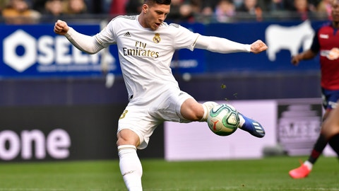<p>               Real Madrid's Luka Jovic kicks the ball to score during the Spanish La Liga soccer match between Osasuna and Real Madrid at El Sadar stadium in Pamplona, northern Spain, Sunday, Feb. 9, 2020. (AP Photo/Alvaro Barrientos)             </p>