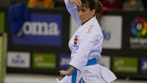 <p>               In this photo provided by the Spanish karate federation, Spanish karate athlete Sandra Sanchez takes part in a Senior Female Kata - Final bout in Madrid, Spain, on Dec. 1, 2019.  Personal determination has taken Sanchez to the top of the world rankings, and in a few months from now the 38-year old will reach the biggest moment of her career by competing in the inaugural Olympic karate tournament at the upcoming summer Tokyo Olympic Games. (Xavier Servolle, Kphotos, Via AP)             </p>