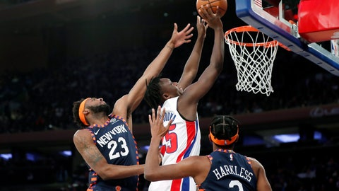 <p>               New York Knicks center Mitchell Robinson (23) defends Detroit Pistons forward Sekou Doumbouya (45) during the first half of an NBA basketball game in New York, Sunday, March 8, 2020. Knicks forward Maurice Harkless (3) watches, lower right. (AP Photo/Kathy Willens)             </p>
