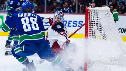 <p>               Vancouver Canucks center Adam Gaudette (88) fails to get a shot past Columbus Blue Jackets goaltender Elvis Merzlikins (90) during the second period of an NHL hockey game in Vancouver, British Columbia, Sunday, March 8, 2020. (Jonathan Hayward/The Canadian Press via AP)             </p>