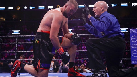 <p>               Romania's Razvan Cojanu, left, reacts as the referee counts for him after he was knocked down during the eighth round of a heavyweight boxing match against Nigeria's Efe Ajagba Saturday, March 7, 2020, in New York. Ajagba stopped Cojanu in the ninth round. (AP Photo/Frank Franklin II)             </p>