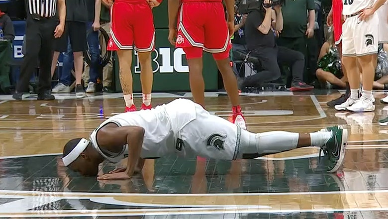Cassius Winston and fellow Michigan State seniors kiss the Spartan logo in final home game