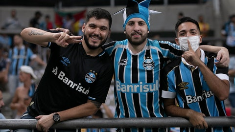 <p>               Fans of Brazil's Gremio pose for a photo prior to a Copa Libertadores soccer match against Internacional at Gremio Arena in Porto Alegre, Brazil, Thursday, March 12, 2020. (AP Photo/Liamara Polli)             </p>